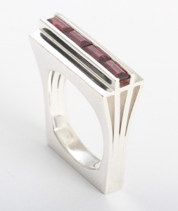 Art-deco inspired cocktail ring Channel-set rhodalite garnets in sterling silver